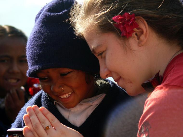 A young Nepali girl sees a photo for herself for the first time
