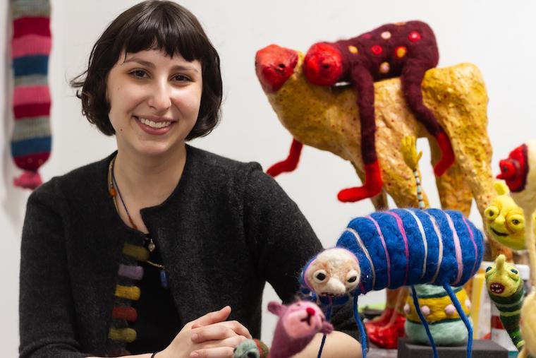 Headshot of Nina Josephson with her artwork