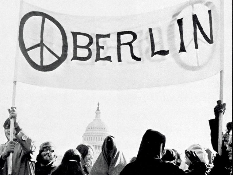 students standing under an Oberlin banner in Washington D.C.