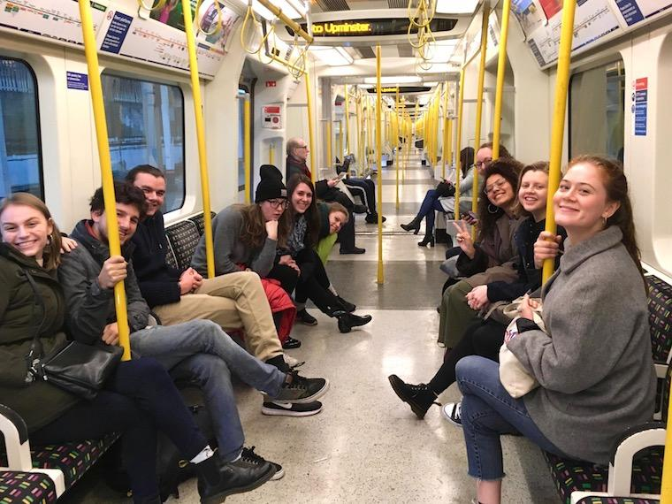 Students traveling via tube in London
