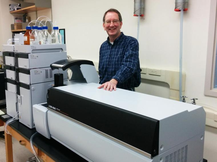 Prof. Thompson and lab equipment