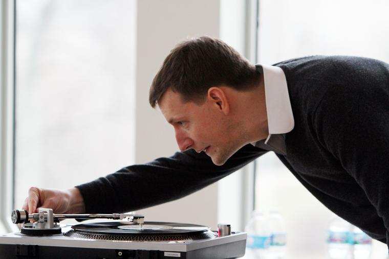 Chris Eldridge '04 of the Punch Brothers spinning a record