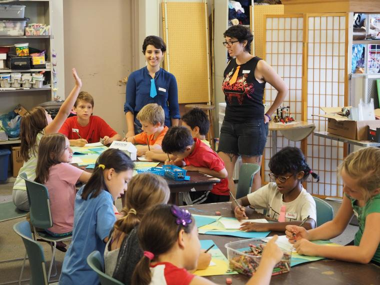 Elementary school students engage in hands-on activities.