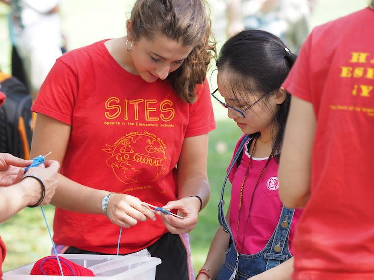 students in SITES program knitting small object