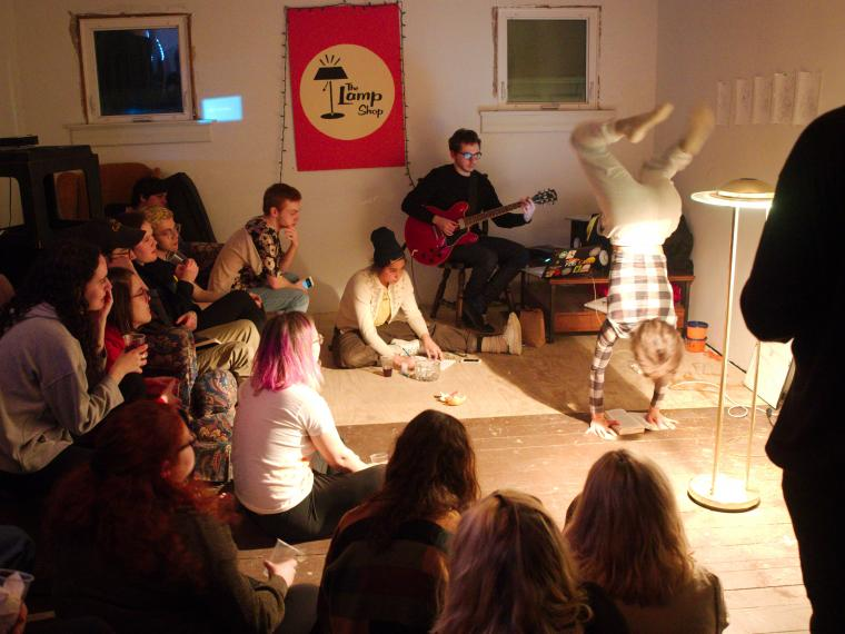 Students perform at an improvisational performance art show