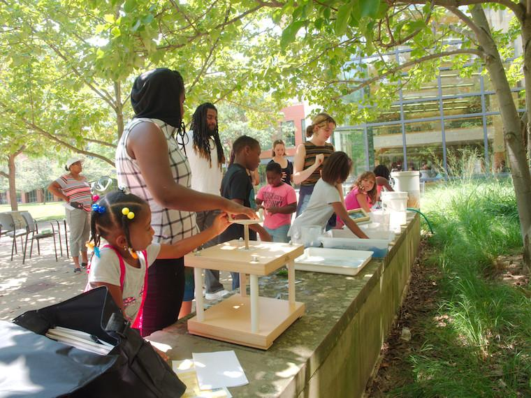 adults and children working together to build science projects