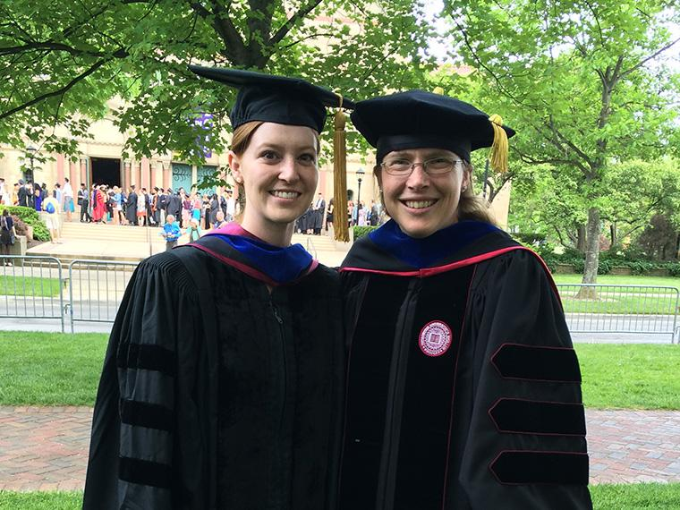 two women dressed in regalia at Oberlin Commencement