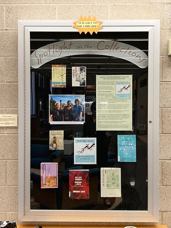 A library display case of the Sato book donation.