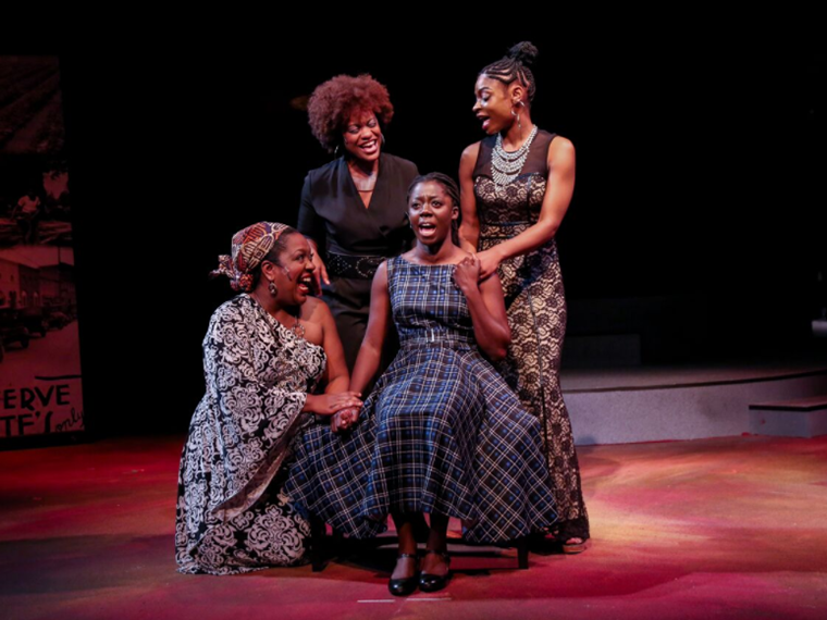Four women singing on stage at Karamu House in a production of Simply Simone