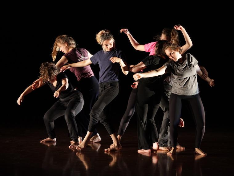 Six dancers perform contemporary group movement