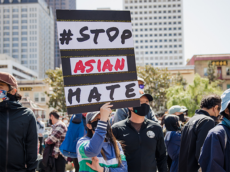 Protestor holds a # Stop Asian Hate sign