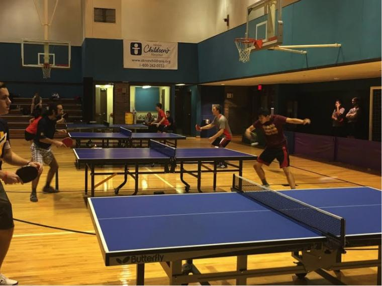 Table tennis matches in action on 4 tables.