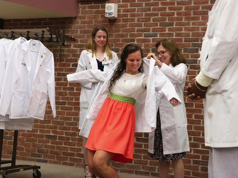 student putting on lab coat