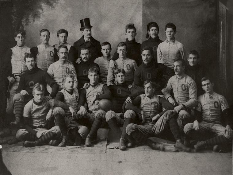 Oberlin College Varsity Football team 1892 posing together.
