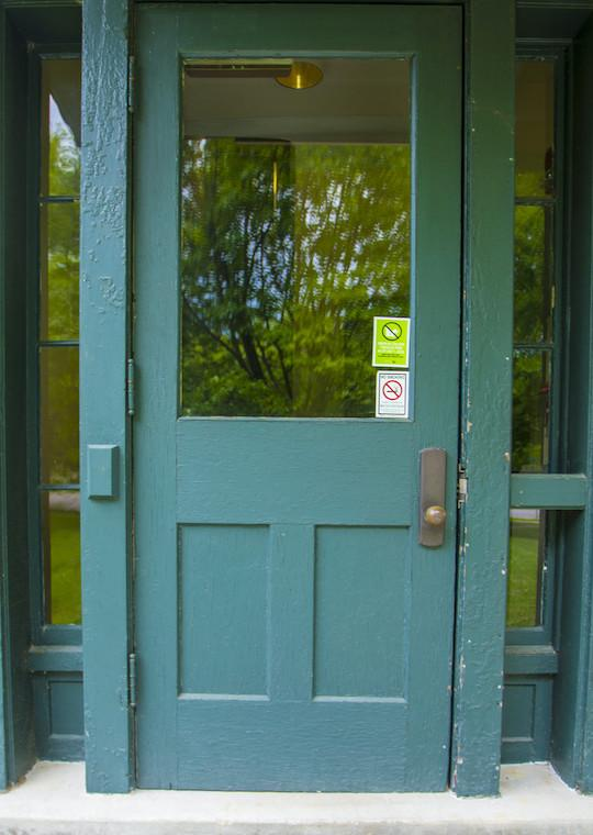 A door with a large glass window and two sidelights