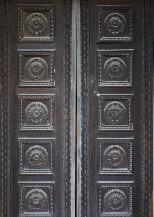 Slender tall double doors with eight panels.