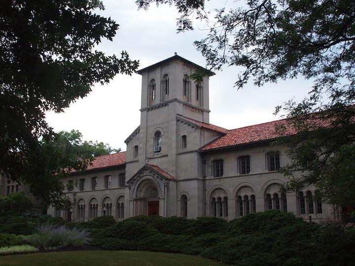 A long building with a bell tower in the center.