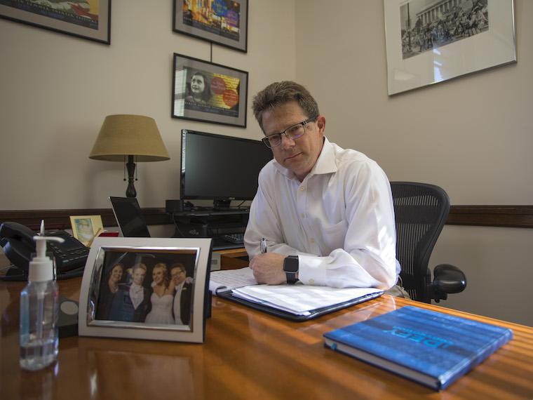 david hertz sitting behind desk in his office.