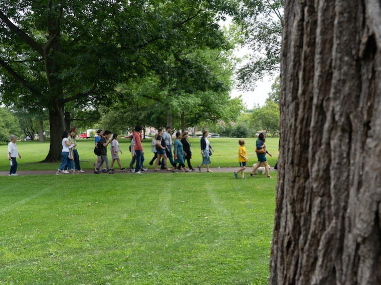 A group of people on a tour in a park.