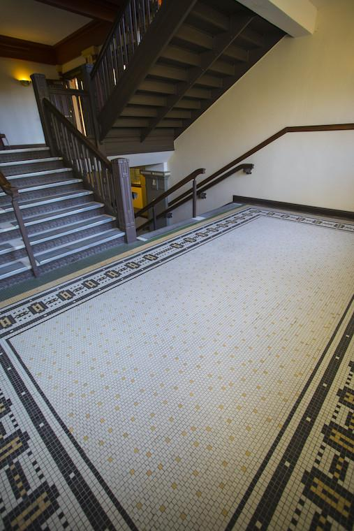 A mid-century staircase and tile floor.