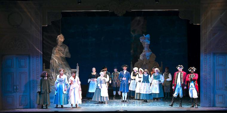 A stage production with people dressed in Victorian attire.