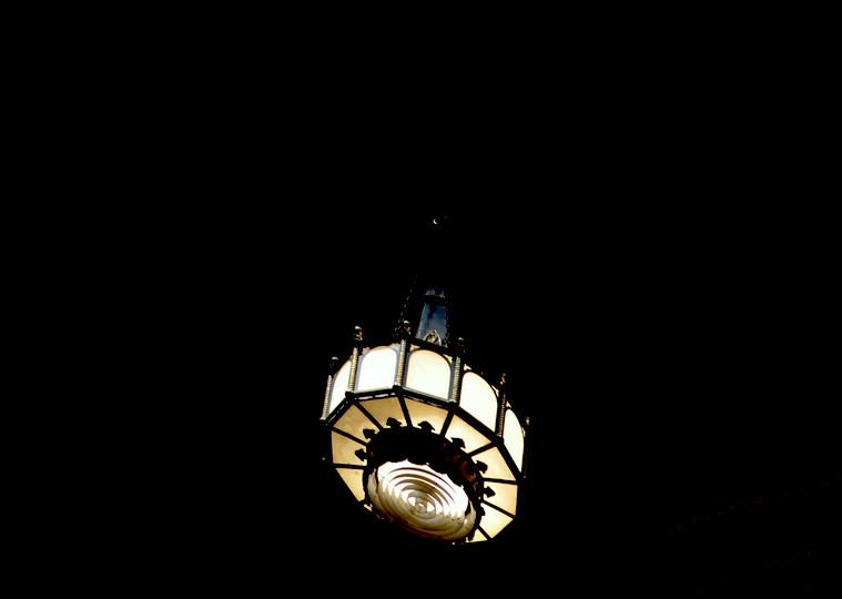 An old round black chandelier