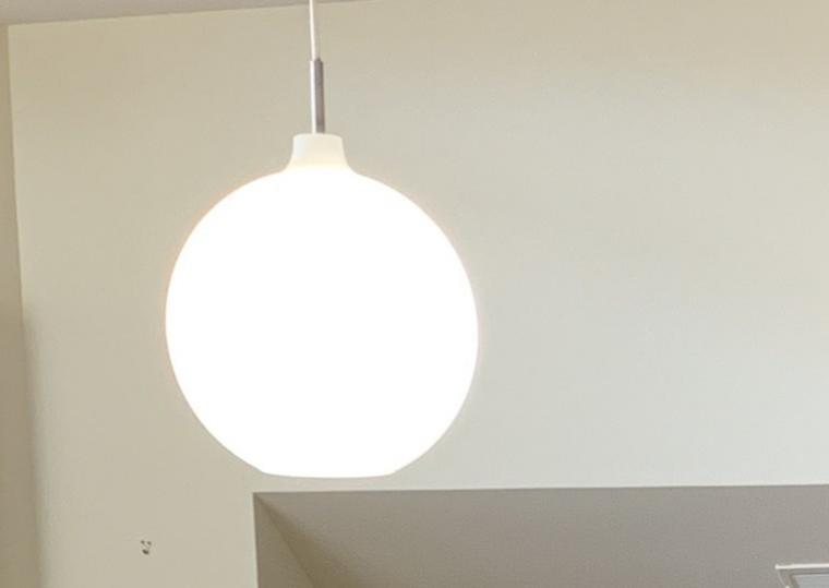Large round light hanging from ceiling