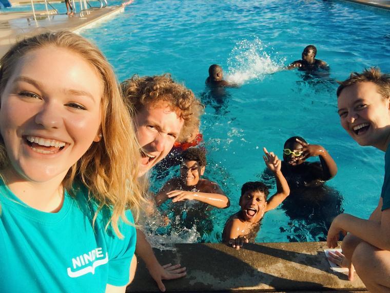 People having fun at the pool.