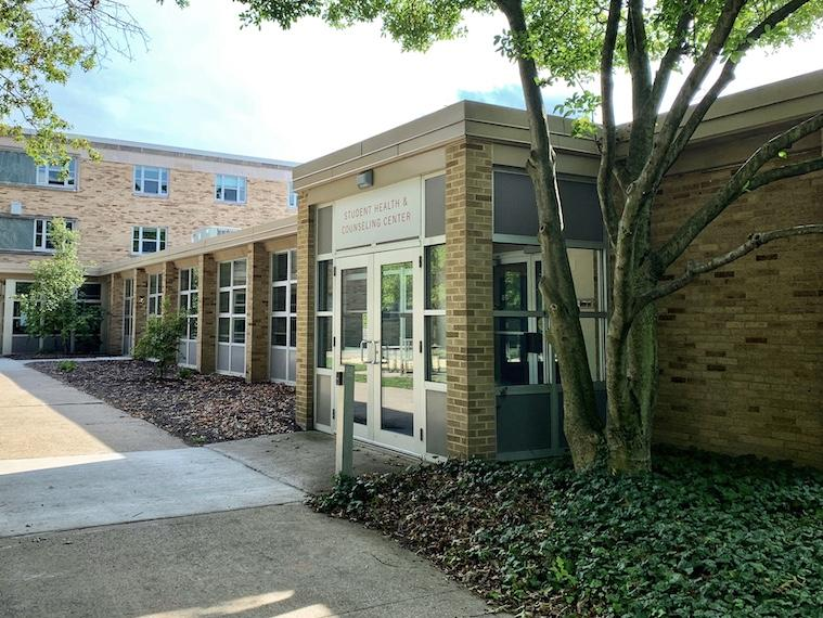 exterior view of building with signage student health and counseling center.