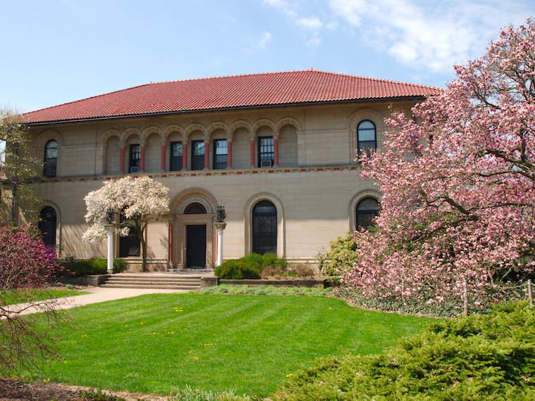 exterior view of Cox Building in spring