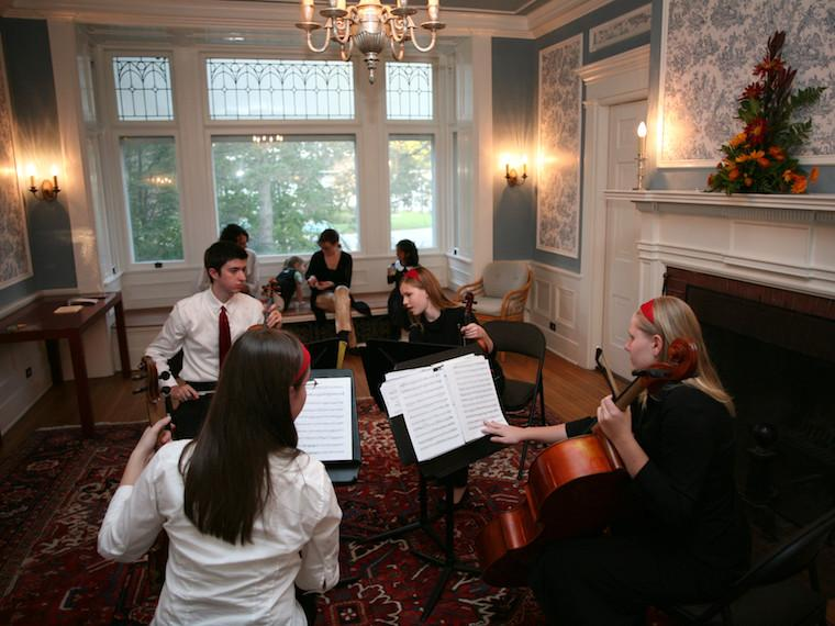 A string quartet performing inside the Burrell-King House