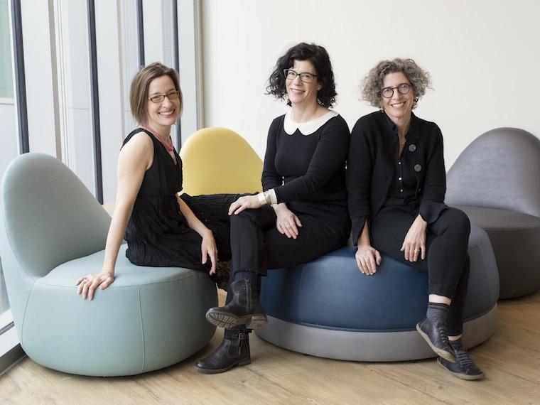 hree women professors sitting in cushy chairs. Photo.