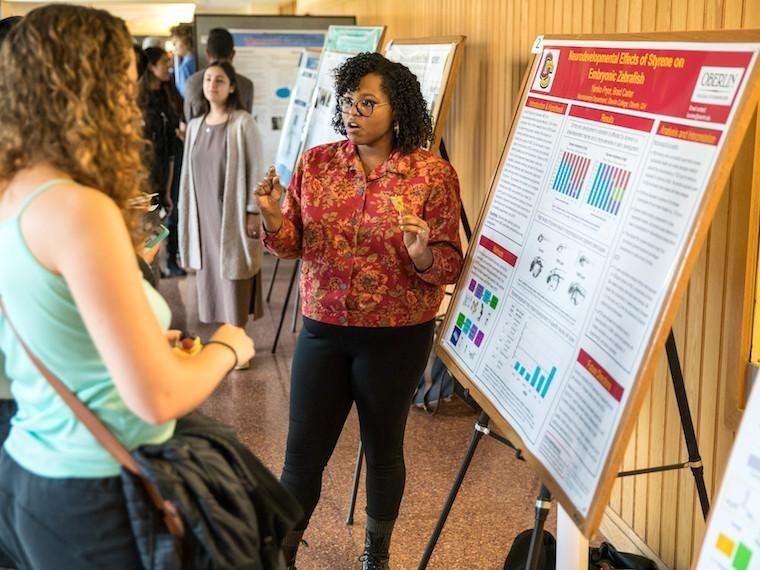 Biology major Yemko Pryor presenting research poster