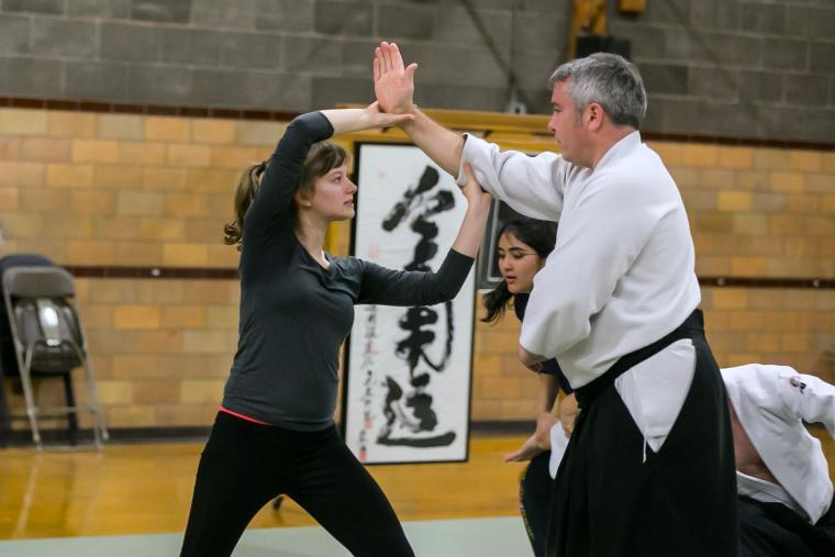 A student practices aikido