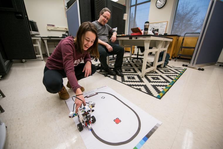 Student and professor testing lego robot