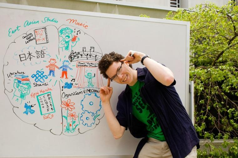 Photo of a man in front of a whiteboard