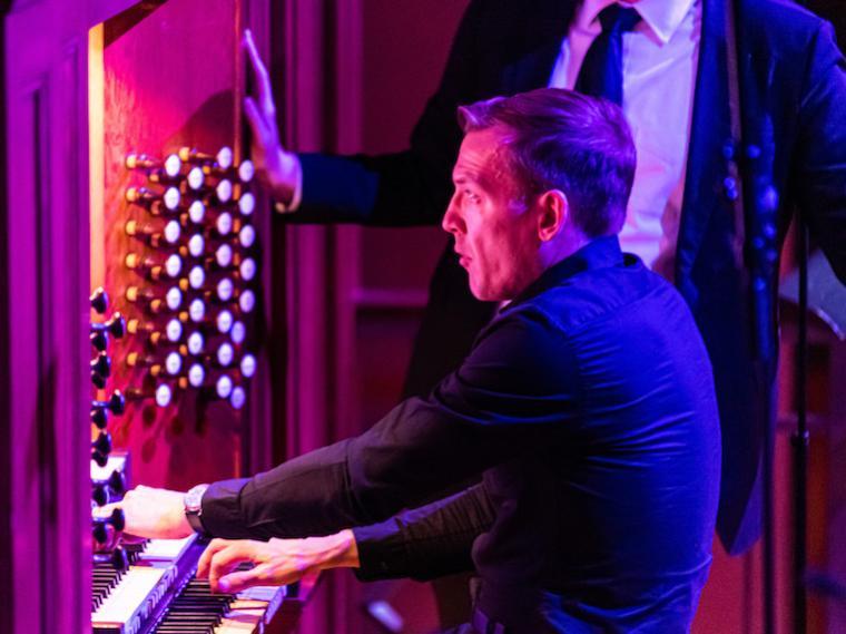 An organist plays the organ.