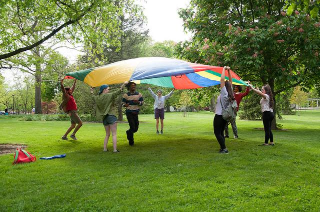 Photograph of people using an umbrella prop.