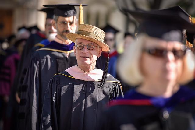 Photo of a line of professors dressed in commencement regalia