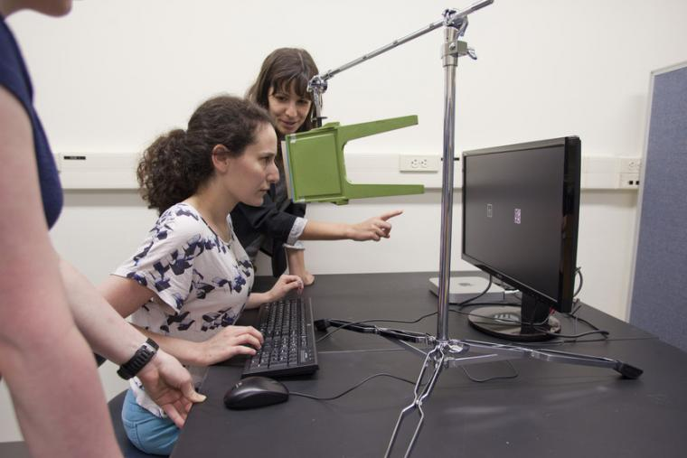 Two women in front of a computer.