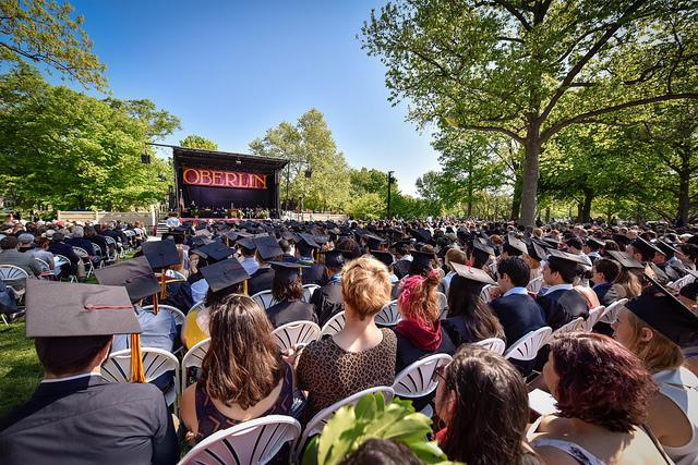 Photo of seated graduates at the commencement assembly