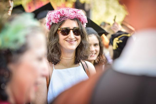 Photo of a woman wearing a floral headdress in a crowd
