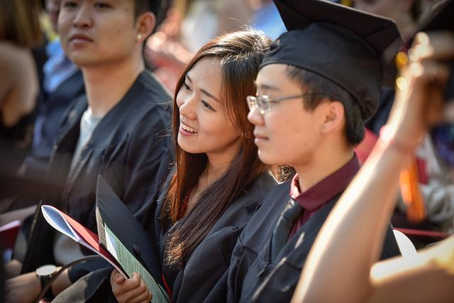 Photo of students clothed in commencement regalia