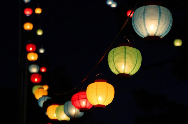 Different color lanterns hanging in a row