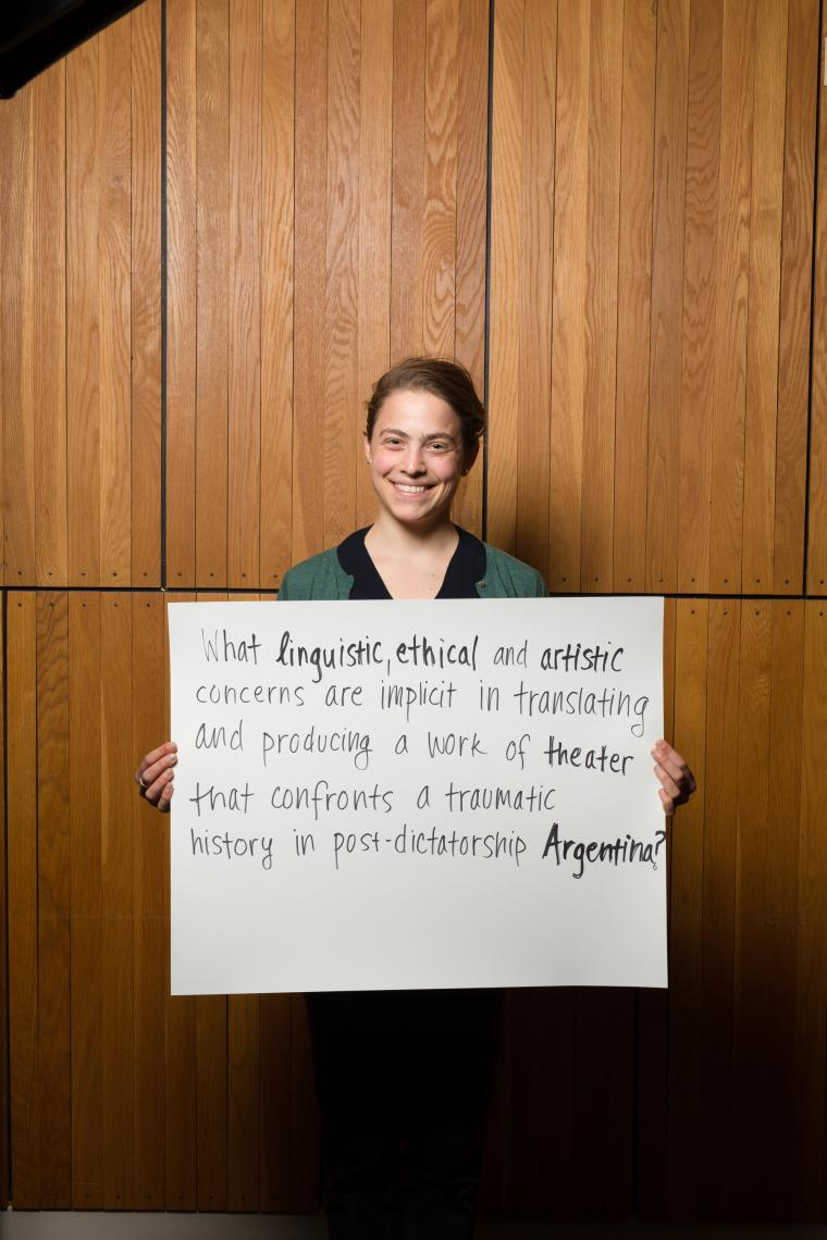 Photo of a woman holding a poster board