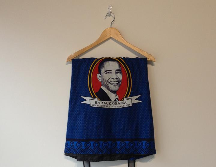 Photograph of a fabric print with a picture of Barack Obama.