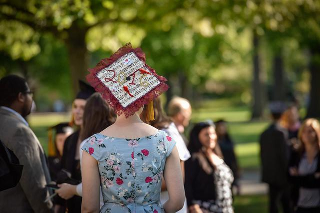 Photo of the back of a person wearing a decorated graduation cap