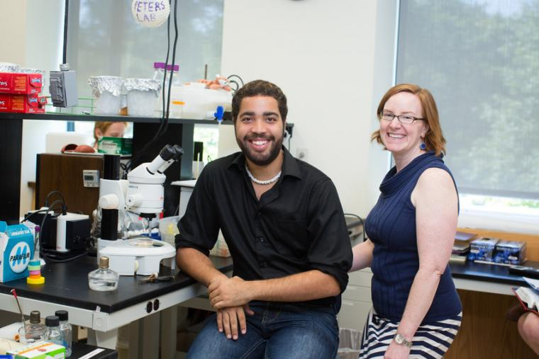 A man and a woman smiling in a lab.