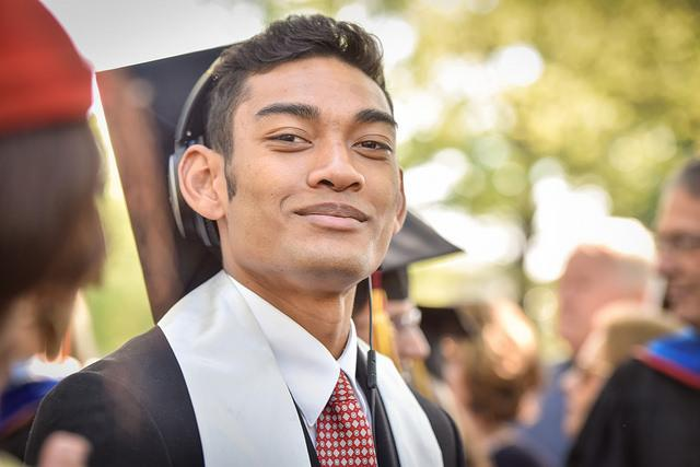 Photo of a man in commencement regalia