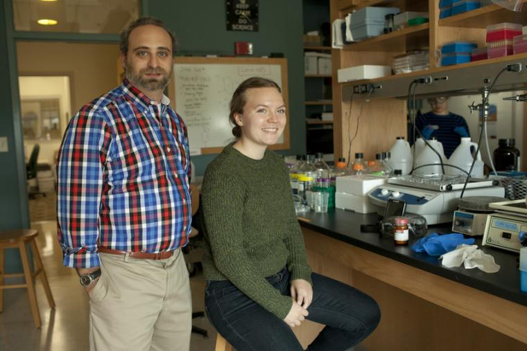 A man and a woman posing in a lab.